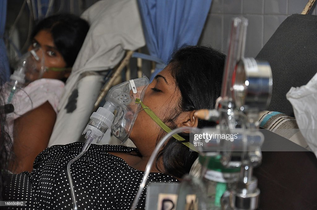 Sri Lankan factory workers receive medical attention at Kalubovila hospital in Colombo on October 22, 2013 after a suspected ammonia gas leak at a detergent manufacturing factory. Sri Lankan authorities shut down a detergent factory in the capital Colombo after more than 70 people were hospitalised following a suspected toxic gas leak, police said.