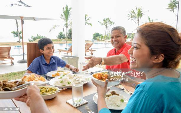 sri lankan family enjoying meal together - sri lankan culture stock pictures, royalty-free photos & images