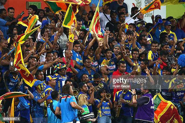 Sri Lankan fans cheer during the 2015 ICC Cricket World Cup Quarter Final match between South Africa and Sri Lanka at Sydney Cricket Ground on March...
