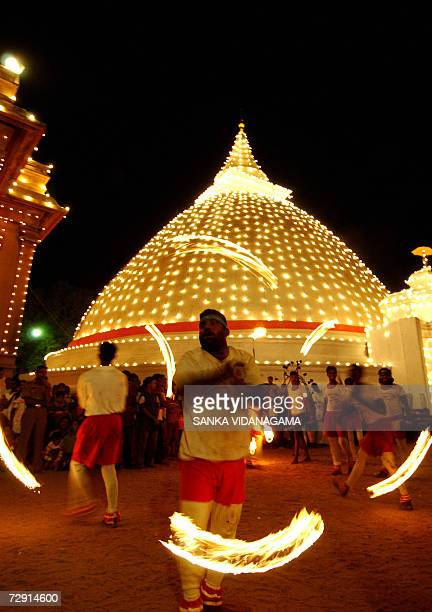 Sri Lankan fire dancer performs during the annual Duruthu traditional procession at Kelani temple in Kelaniya suburb Colombo 02 January 2007 prior to...