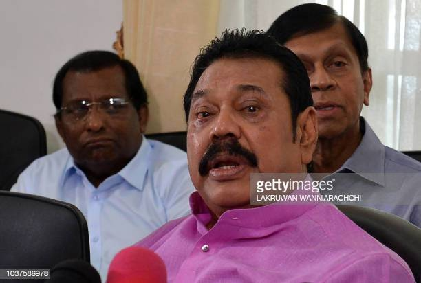 Sri Lankan former president Mahinda Rajapakse addresses reporters at his residence in Colombo on September 22 demanding fresh elections as a way to...