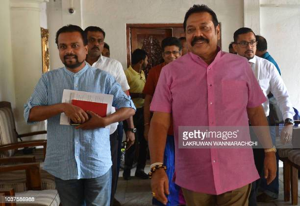 Sri Lankan former president Mahinda Rajapakse walks away after addressing reporters at his residence in Colombo on September 22 demanding fresh...