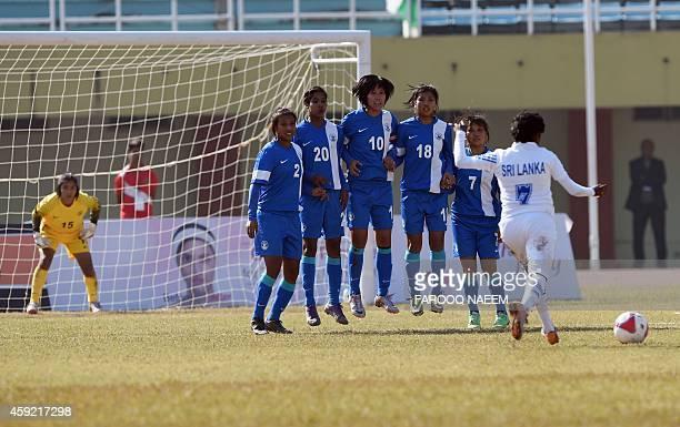 Sri Lankan forward ILEKumudumala takes a penalty shot at goal as Indian defenders line up during the semifinal of the 3rd South Asian Football...