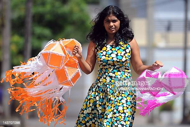 A Sri Lankan girl carries lanterns on the eve of Vesak Festival in Colombo on May 3 2012 Sri Lankan Buddhists are preparing to celebrate Vesak which...