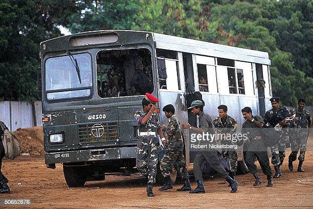 Sri Lankan government army soldiers boarding a bus to go on home leave after serving in Jaffa in the war against the Tamil Tigers