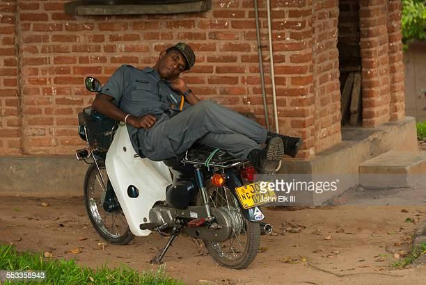 Sri Lankan guard napping on motorbike