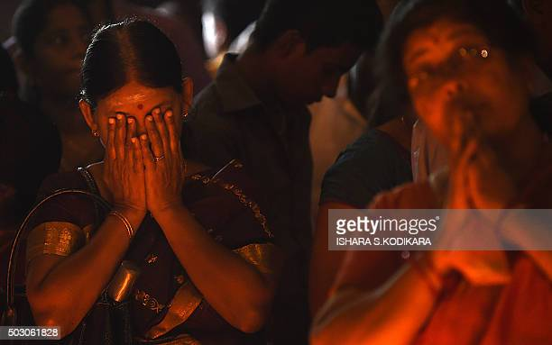 Sri Lankan Hindu devotee prays at a Hindu temple in Colombo on January 1, 2016. Many Sri Lankans marked the beginning of the 2016 New Year with...