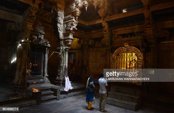 Sri Lankan Hindu devotees offer prayers at a Hindu temple in Colombo on January 14 2018 Hindus in Sri Lanka are celebrating the Thai Pongal festival...