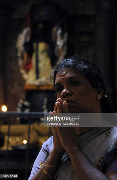 A Sri Lankan Hindu woman offers prayers at a Hindu Temple in Colombo on January 14 2009 on the occasion of the 'Pongal' festival The fourday 'Pongal'...