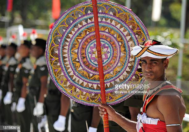 Sri Lankan Kandyan dancer looks on during an opening ceremony in Buttala on January 23, 2012. Lalith Weeratunga, Secretary to Sri Lankan President...