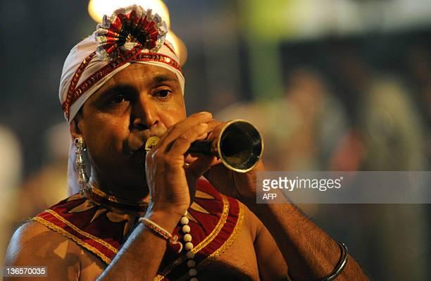 Sri Lankan Kandyan dancer performs during the annual Perahera festival of the historic Kelaniya Buddhist Temple in Kelaniya on January 8, 2012....