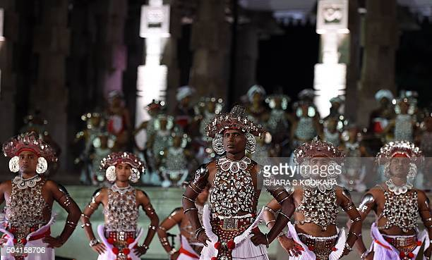 Sri Lankan Kandyan dancers perform during a cultural show at Independence Square in Colombo on January 9, 2016. President Sirisena marked his first...