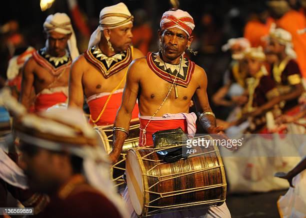 Sri Lankan Kandyan dancers perform during the annual Perahera festival of the historic Kelaniya Buddhist Temple in Kelaniya on January 8, 2012....