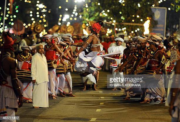 Sri Lankan Kandyan dancers perform in front of the Gangarama Temple during the Navam Perahera festival in Colombo on February 3, 2015. Monks,...
