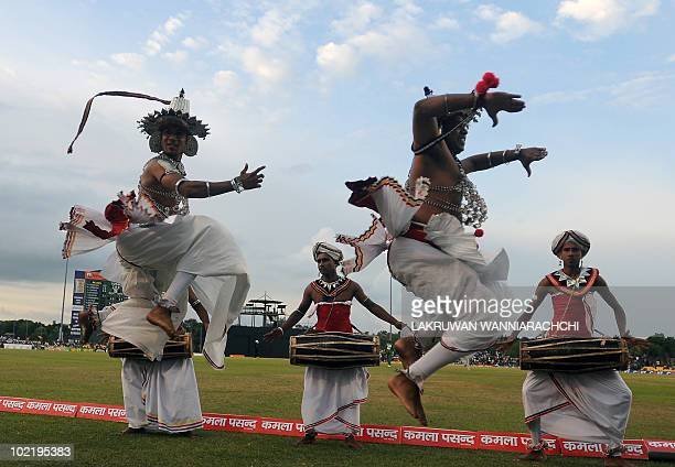 Sri Lankan Kandyan dancers perform on the sidelines during the third One Day International cricket match of the Asia Cup between Sri Lanka and...