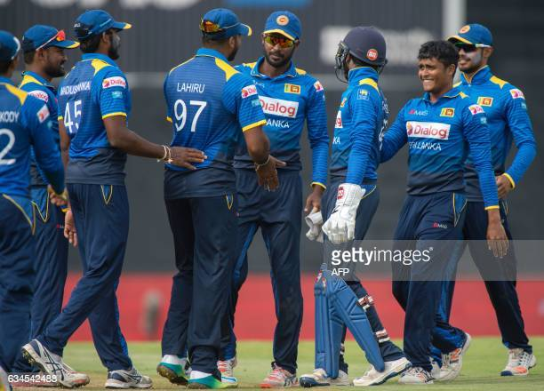 Sri Lankan Lahiru Kumara celebrates after catching out South African AB de Villiers during the fifth and last One Day International cricket match...