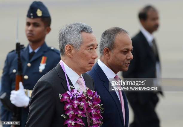 Sri Lankan Law and Order Minister Sagala Ratnayaka greets Singapore Prime Minister Lee Hsien Loong during a welcoming ceremony at the Bandaranaike...