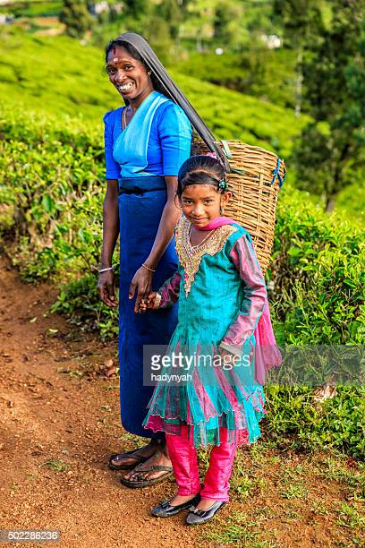Sri Lankan little girl walking with mother, Nuwara Eliya, Ceylon