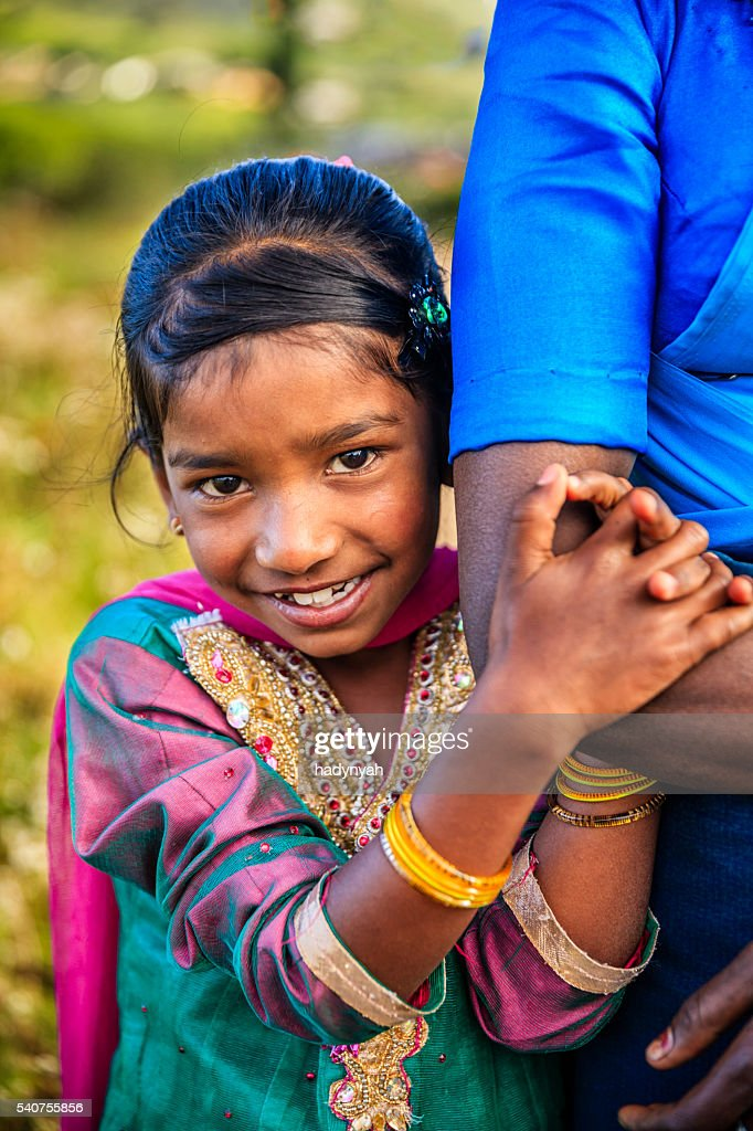 Sri Lankan Little Girl With Lotus Flowers High-Res Stock