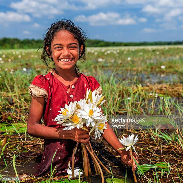 Sri Lankan little girl with lotus flowers
