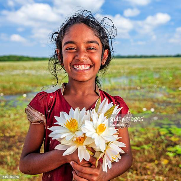 Sri Lankan little girl with lotus flowers