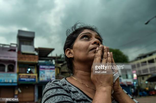 Sri Lankan local people pray near to St Anthony Church on April 23 2019 evening in Colombo Sri Lanka At least 321 people were killed with hundreds...