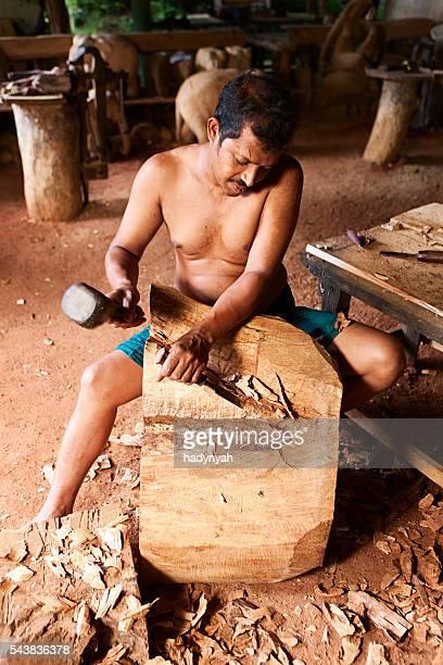Sri Lankan man carving a wood sculpture. Kandy
