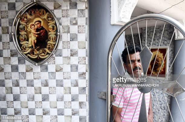 Sri Lankan man looks on as he stands outside St. Anthony's Shrine in Colombo on April 29 a week after a series of bomb blasts targeting churches and...