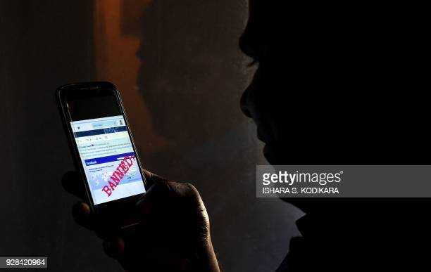 A Sri Lankan man mobile phone user shows an image on Twitter showing that the Facebook site had been blocked in Colombo on March 7 2018...