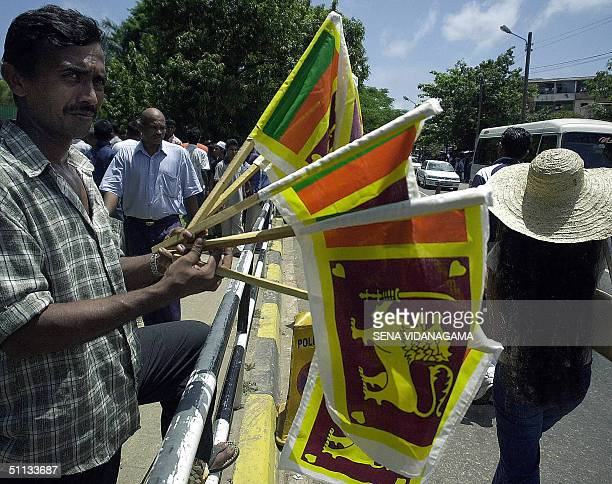 Sri Lankan man sells his countries flag as crowds gather prior to the start of the Asia Cup Final in which India will play Sri Lanka at The R...