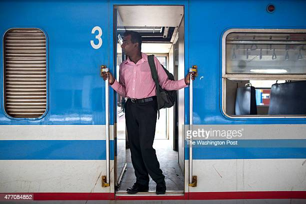 Sri Lankan man stands on the train coming from Colombo at the Jaffna train station The popular Sri Lankan rail service known as the 'Queen of Jaffna'...