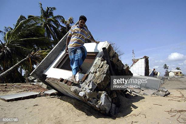 Sri Lankan man Syed fazeel Maulana who lost 16 members of his family in the 26 December tsunamis visits his destroyed house in Hambantota 250 km...