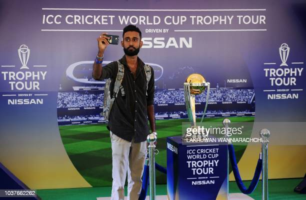 A Sri Lankan man takes selfie with the 2019 ICC Cricket World Cup trophy during an event in Colombo September 22 2018 The 2019 Cricket World Cup is...