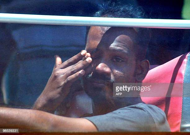 A Sri Lankan man wipes his eyes as he and another 119 ethnic Tamils migrants leave their boat at Merak seaport in Banten province on April 19 2010...