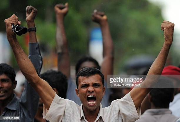 Sri Lankan Marxist JVP party activists shouts slogans during a protest in Colombo on February 15, 2012. Sri Lanka's Marxist JVP party took to the...