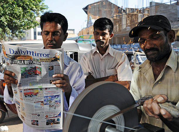 Sri Lankan Men Read Newspapers Carrying Pictures Getty Images