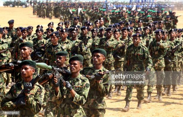 Sri Lankan military officers march during military parade rehearsals in preparation for the celebration of the third anniversary of the end of the...