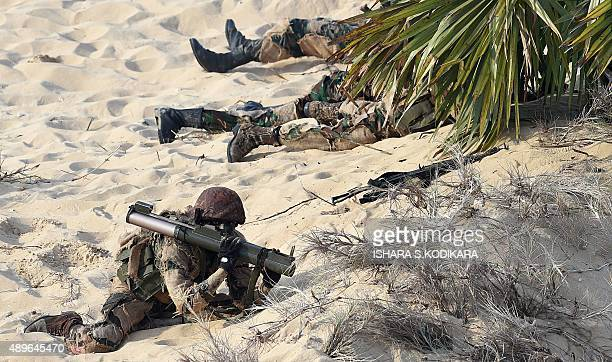 Sri Lankan military personnel take part in a joint training excercise with some 2500 members of the army navy and airforce on the eastern coast of...