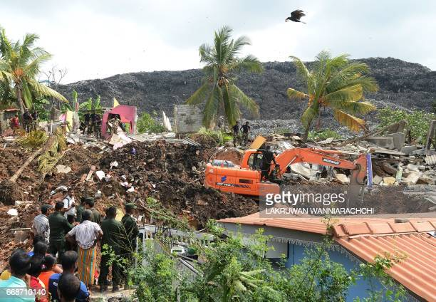 Sri Lankan military rescue workers carry out a rescue operation at the site of a collapsed garbage dump in Colombo on April 15 2017 The death toll...