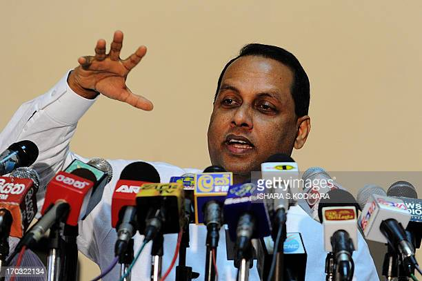 Sri Lankan Minister of Disaster Management Mahinda Amaraweera addresses journalists in Colombo on June 11 2013 Sri Lanka will introduce mandatory...
