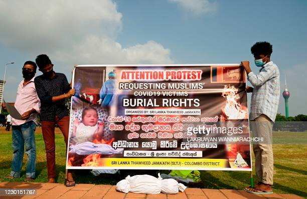 Sri Lankan minority Muslims hold a banner as they demonstrate near the office of President Gotabaya Rajapaksa, in Colombo on December 16, 2020.