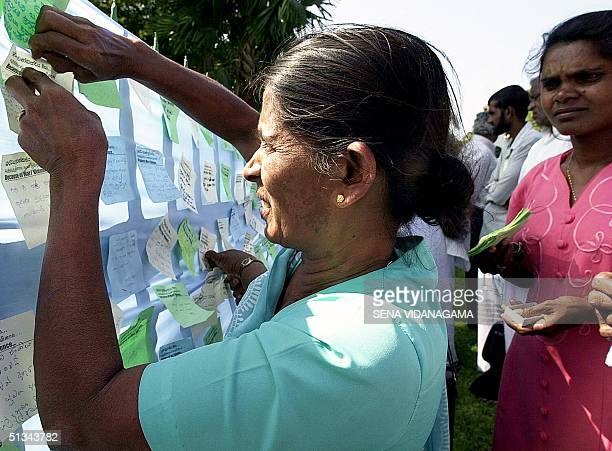 Sri Lankan mother enters the name of her soldier son on a flagforpeace campaign in the capital Colombo 11 December 2000 demanding an end to the...