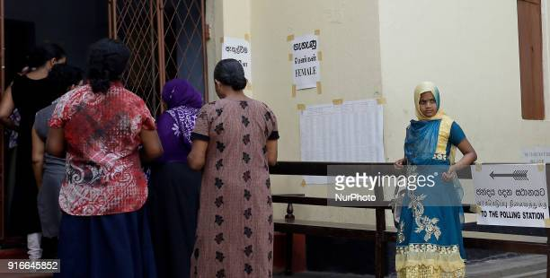 A Sri Lankan Muslim girl awaits for her mother as women voters line up to cast votes at a polling station in Colombo Sri Lanka on Saturday 10...