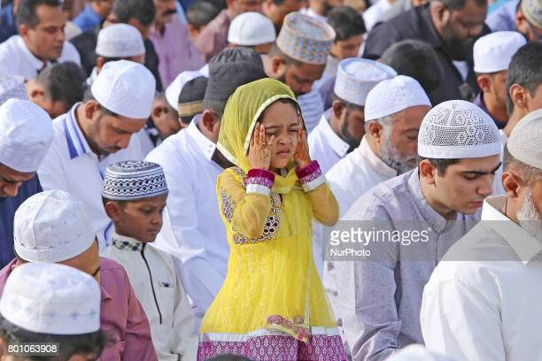 A Sri Lankan Muslim girl offers prayers amid adult Muslim men during the Eid alFitr prayers to mark the end of the holy fasting month of Ramadan in...