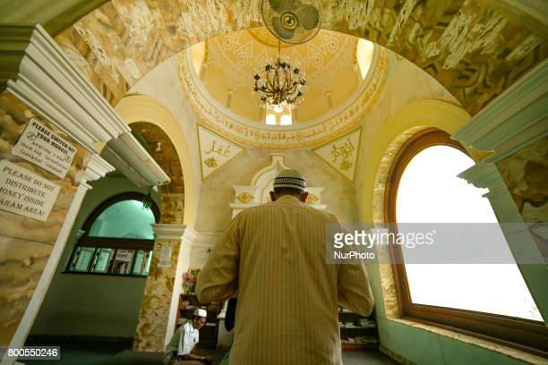 A Sri Lankan Muslim man offers prayers inside a mosque in Colombo Sri Lanka on Saturday 24 2017Muslims across the world are marking the holy month of...