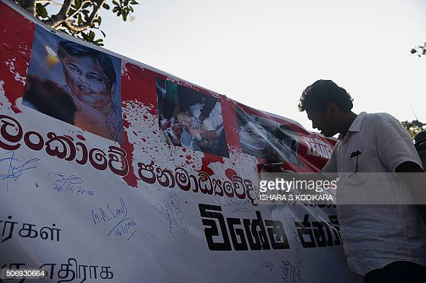 Sri lankan Muslim man signs a banner in Colombo on January 26, 2016. The silent demonstration aims to pressure the government to appoint a special...