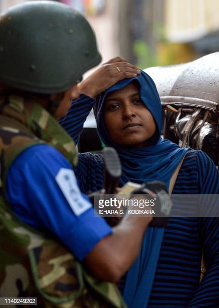 A Sri Lankan Muslim woman looks on at a checkpoint in Colombo on April 30 2019 Religious tensions and a government ban on covering the face since the...