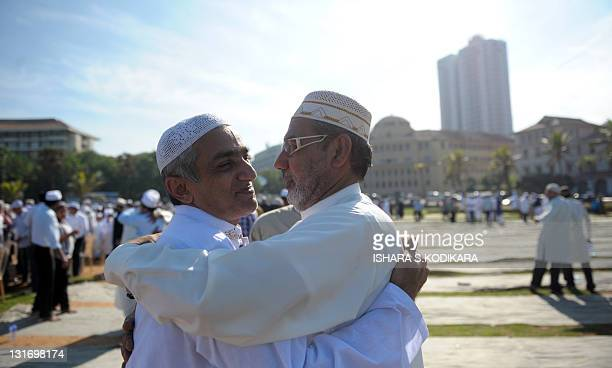 Sri Lankan Muslims greet each other after prayers for Eid AlAdha celebrations at the Galle Face esplanade in Colombo on November 7 2011 Islam's...