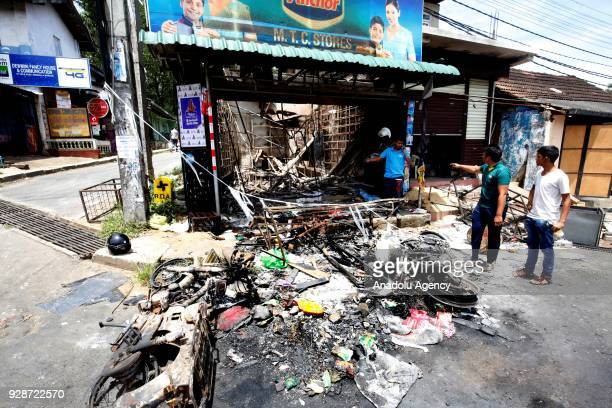 Sri Lankan Muslims inspect their fire gutted remains of a business establishment at the Digana town in Kandy 117 kms from Colombo Sri Lanka 7 March...