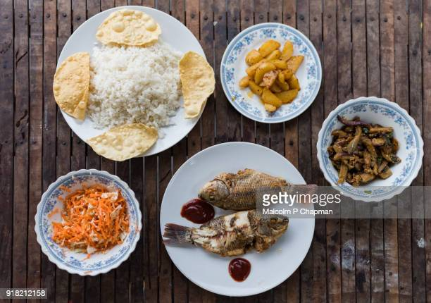 sri lankan national dish - rice and curry with fish and small vegetable dishes - sri lanka stock pictures, royalty-free photos & images